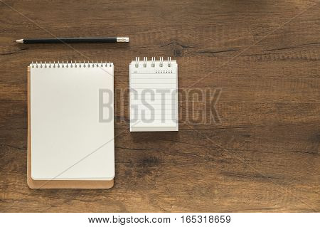 Note And Pencil On Working Desk
