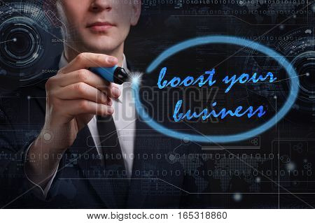 Business, Technology, Internet And Network Concept. Young Business Man Writing Word: Boost Your Busi