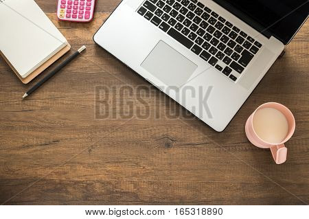 Working desk, Office and home office concept. with Laptop, Pencil, Memo and Clock on wooden table.