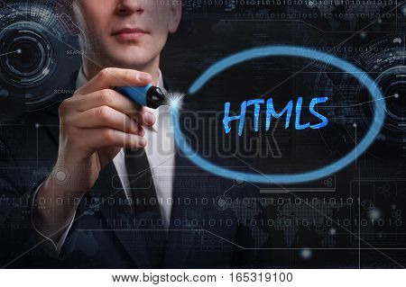 Business, Technology, Internet And Network Concept. Young Business Man Writing Word: Html5