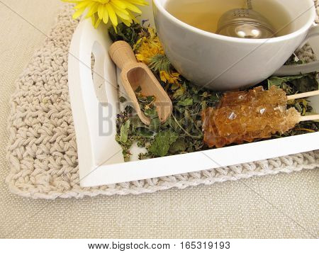 Herbal tea with marigold and cornflower with tea infuser ball
