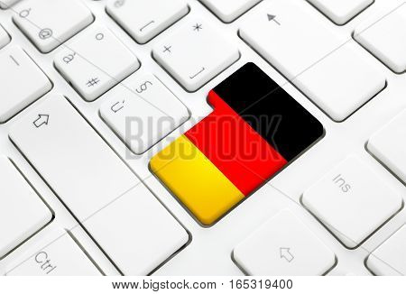 German language or Germany web concept. National flag enter button or key on white keyboard