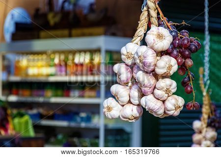 Hanging Garlics And Grapes