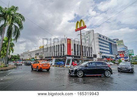 Bandar Seri Begawan,Brunei-Nov 11,2016:View on the main street in Bandar Seri Begawan,Brunei with buildings and a walkway,cars on the road in the background.