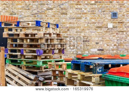 Pile of wooden pallets at a recycling yard