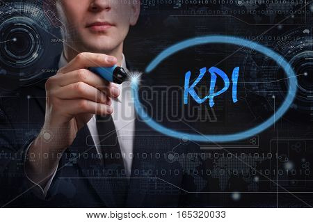 Business, Technology, Internet And Network Concept. Young Business Man Writing Word: Kpi