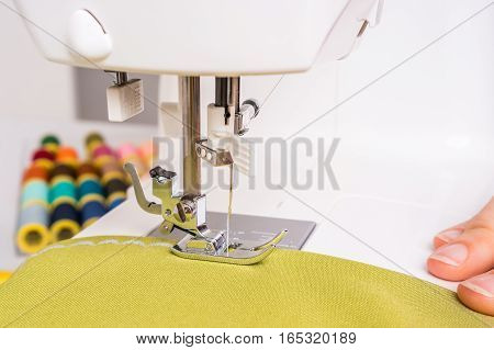 Seamstress Is Sewing On Sewing Machine
