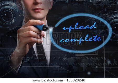 Business, Technology, Internet And Network Concept. Young Business Man Writing Word: Upload Complete