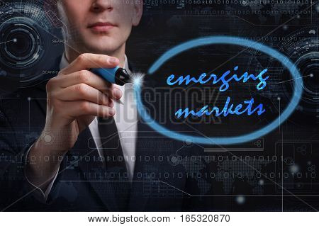 Business, Technology, Internet And Network Concept. Young Business Man Writing Word: Emerging Market