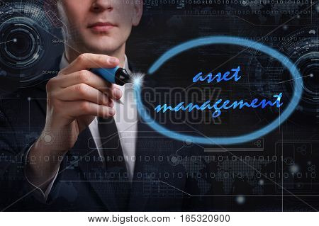 Business, Technology, Internet And Network Concept. Young Business Man Writing Word: Asset Managemen