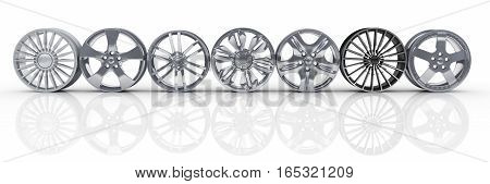 seven car hubcaps on a white background. 3d illustration