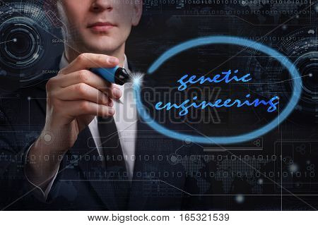 Business, Technology, Internet And Network Concept. Young Business Man Writing Word: Genetic Enginee