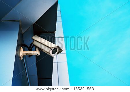 Surveillance camera on modern building for private property protection