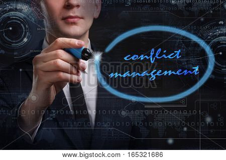 Business, Technology, Internet And Network Concept. Young Business Man Writing Word: Conflict Manage