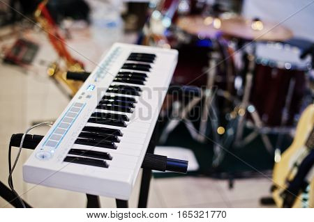 Electric piano synthesizer keyboard on rock stage