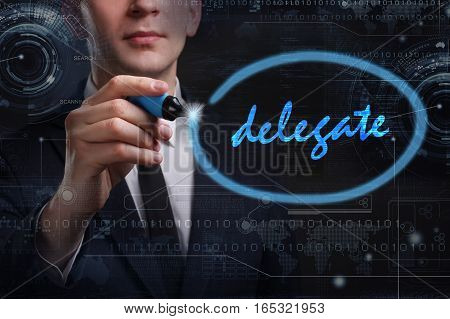 Business, Technology, Internet And Network Concept. Young Business Man Writing Word: Delegate