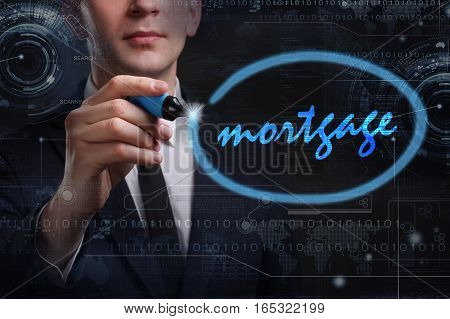 Business, Technology, Internet And Network Concept. Young Business Man Writing Word: Mortgage