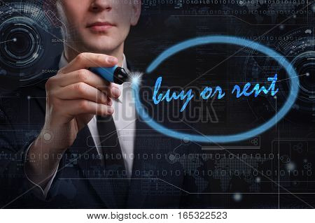 Business, Technology, Internet And Network Concept. Young Business Man Writing Word: Buy Or Rent