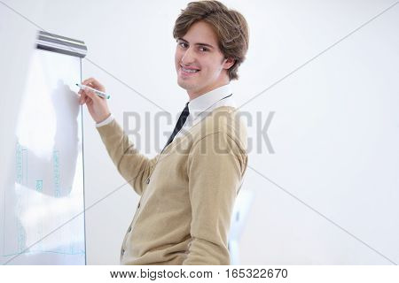 Freelancer looking at his ideas written on paper at modern startup office