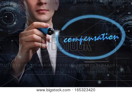 Business, Technology, Internet And Network Concept. Young Business Man Writing Word: Compensation
