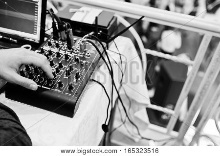 Hand Of Man On Digital Mixing Console. Sound Mixer Control Panel, Closeup Of Audio Faders.