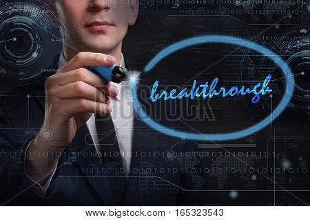 Business, Technology, Internet And Network Concept. Young Business Man Writing Word: Breakthrough