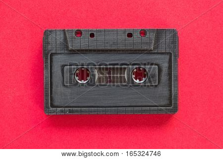 old vintage style cassette tape on a plain background