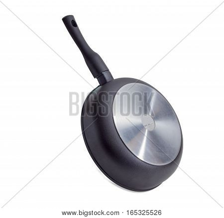 Cast frying pan made of aluminium alloy with removable handle on a light background