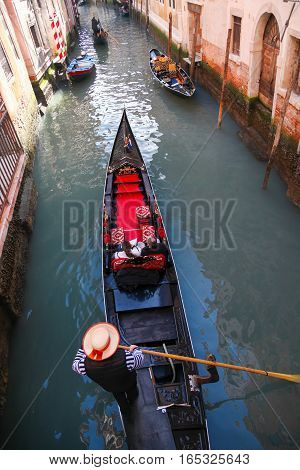 Gondolas on canal in famous Venice Italy