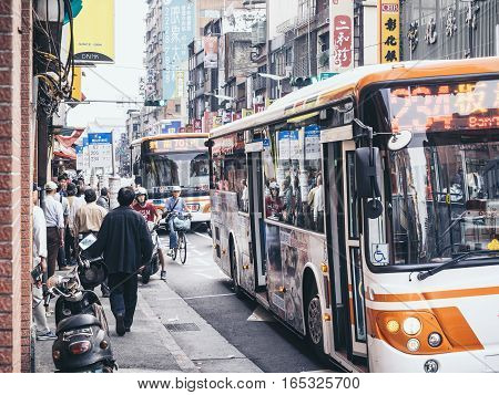 TAIPEI TAIWAN - March 19 2015 : Taipei Bus Stop Crowd People Travelling Local Transportation Bus City guide