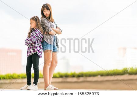 Two sisters mad at each other family issue or relationship concept with copy space