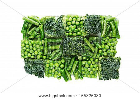 Briquette of assortment fresh frozen green peas french bean broccoli with hoarfrost closeup on white background. Isolated. Healthy vitamin food.
