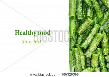 Border of wet fresh green french bean in water closeup on white background. Isolated. Healthy vitamin food.