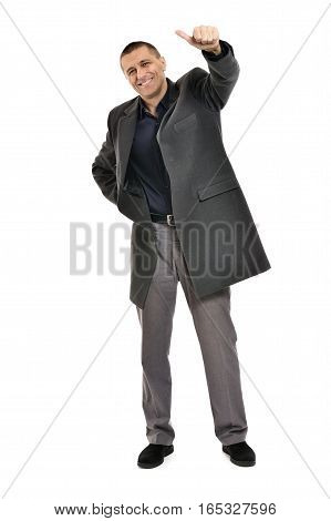 Confident man with thumbs up in coat on a white background