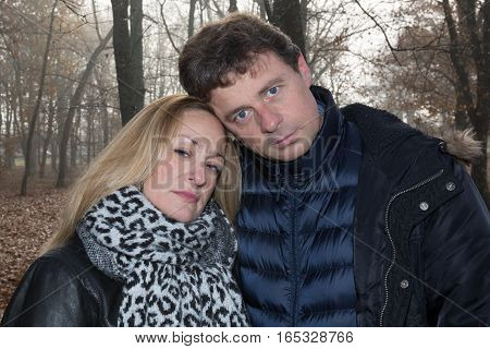 A Man And A Woman Sad In The Winters Both Out Bad News