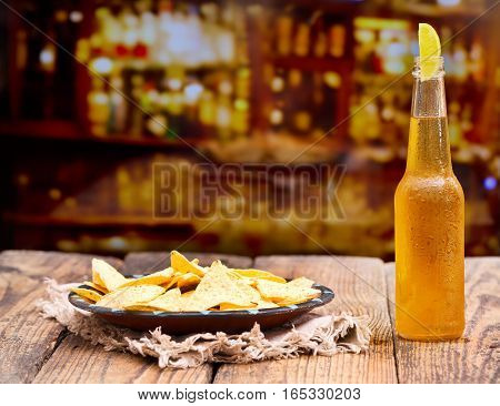 Bottle Of Beer With Lime And  Nachos