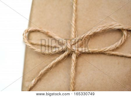 rope with a bow on the box with kraft paper.