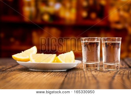 Cold Glasses Of Vodka With Slices Of Lemon