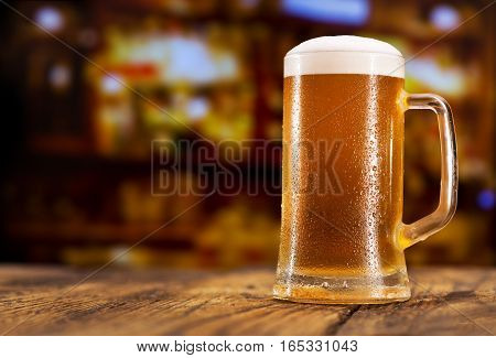 close up of mug of beer in a bar