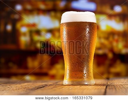 close up of glass of beer in a bar