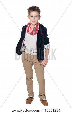 Full length portrait of fashionable little boy in jacket with scarf isolated on white background
