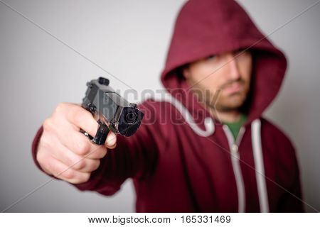 Man Pulling Out A Gun Ready To Shoot