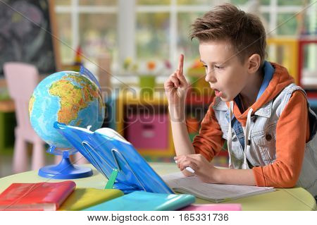 little boy doing homework in the classroom
