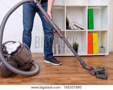 Hoovering a parquet floor cleaning very good