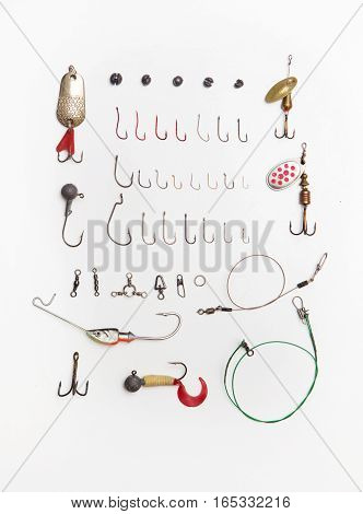 assorted fishing tackle on white background in daylight