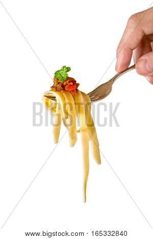mans hand holding a fork with pasta and Bolognese sauce , black background