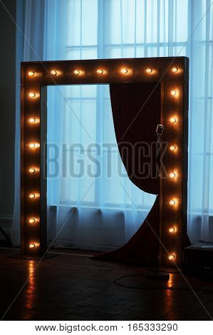 wooden arch with lights adorned for wedding ceremony.