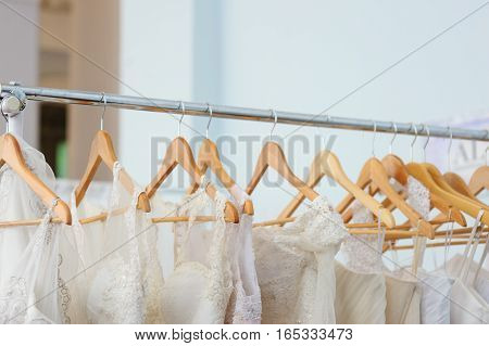 beautiful white bridesmaid dresses hanging on trempel.
