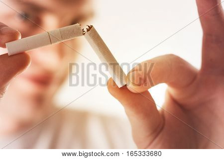 Man, Guy,hipster Holding A Broken Cigarette, Concept Of Healthy Lifestyle, Quit Smoking On A White B