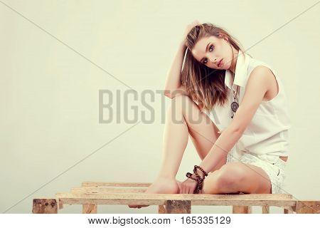 Woman Posing In Studio In Fashion Style